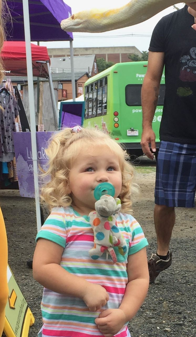 This little sweetie was the highlight of the day. She was her own festival...  especially with her little spotted friend who was holding her pacifier. 4595d8169d69